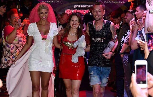 Micaela Schäfer, Blanka Lutz Steve Es (von links) auf der Berlin Fashion Week. Foto: Belmondo Photography