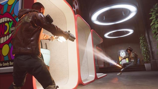 Szene aus Deathloop: Colt und Julianna schießen in einem Gang aufeinander.